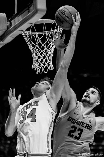 (Trent Nelson | The Salt Lake Tribune) Utah Utes center Jayce Johnson (34) shoots, defended by Oregon State Beavers center Gligorije Rakocevic (23) as Utah hosts Oregon State, NCAA basketball in Salt Lake City on Saturday Feb. 2, 2019.